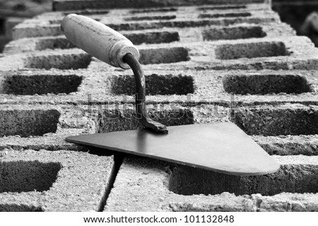 Trowel on a concrete blocks in black and white style - stock photo