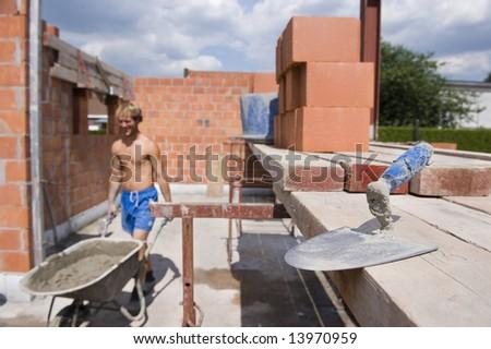 trowel on construction site. Under construction - stock photo