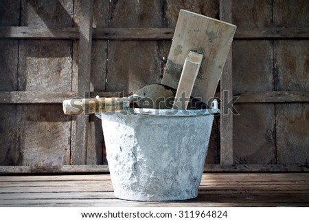 trowel on wood background - stock photo