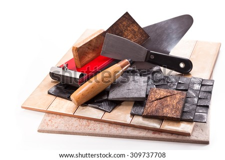 Trowel, spatula, ceramics and decorative tiles, tool with sandpaper on a white background