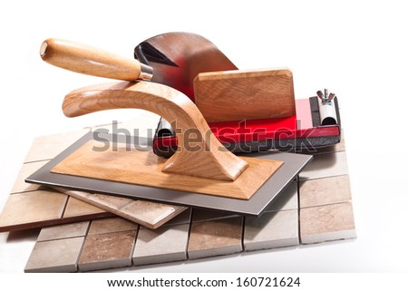 Trowel, trowel, a tool for sanding, ceramic tile on a white background - stock photo