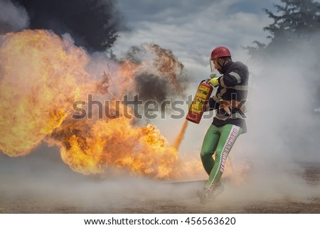 Troyan,Bulgaria - May 17,2016: Regional Competition, firefighter extinguishing a fire,Fire and Rescue Sport