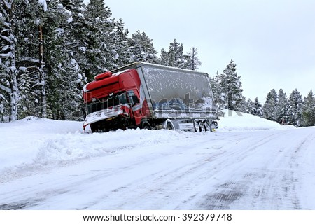 truck accident on snow and icy road