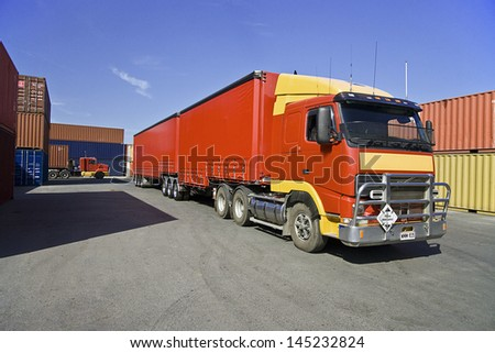 Truck and cargo containers at port