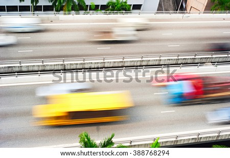 Truck and cars  on a highway in Singapore. Motion blur
