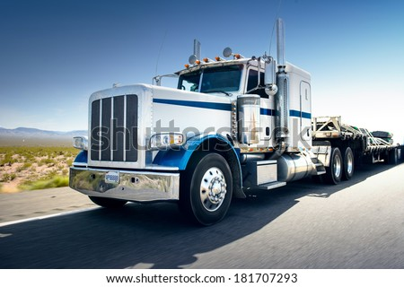 Truck and highway at day - transportation background