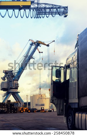 Truck and loading at the port with cranes and forklifts in Europe