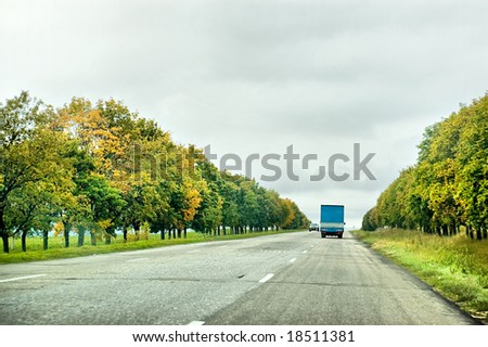 Truck and one car moving on the road - stock photo