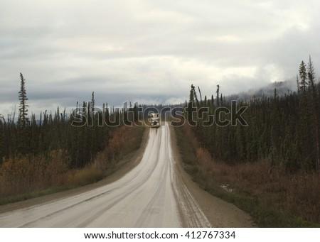 Truck barreling down the Haul Road in Alaska - stock photo