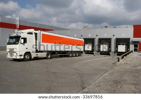Truck by loading docks - stock photo