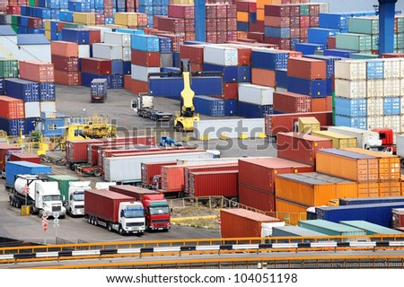 truck carries container to a warehouse near the sea - stock photo