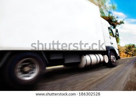 truck carrying merchandise.Close up image of wheels and rim - stock photo