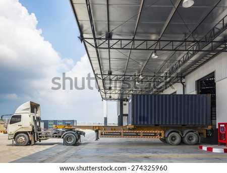 Truck Docking in warehouse at port - stock photo