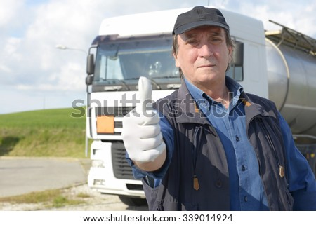 Truck driver with thumbs up - stock photo