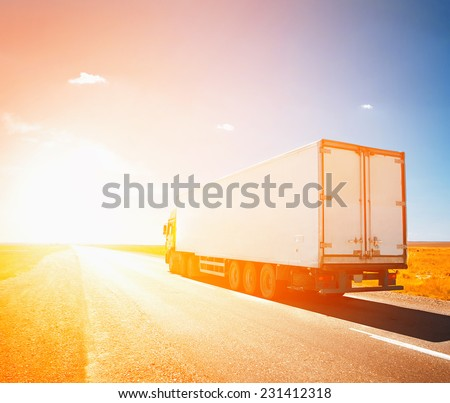 truck driving to sunset - stock photo