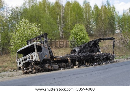 Truck. Fire on the road. - stock photo