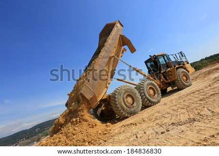 truck in action on a construction site