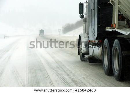 Truck in snow storm near La Grande, Oregon - stock photo