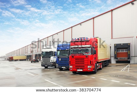 Truck in unloading in warehouse - stock photo