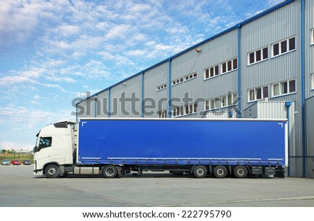 Truck in warehouse - stock photo