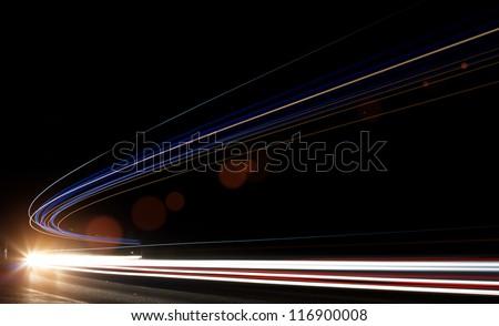 Truck light trails in tunnel. Art image . Long exposure photo taken in a tunnel - stock photo