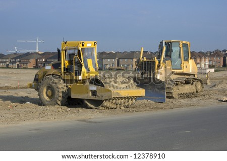 Truck, new houses and house's construction sites