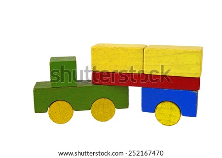 Truck of wooden blocks, traditional toy on white background - stock photo