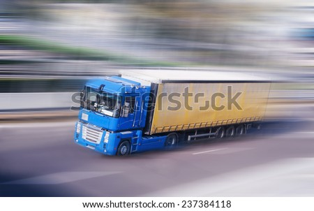 Truck on a fast express road, motion blur - stock photo