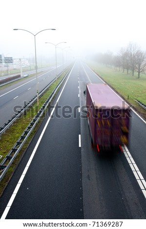 Truck on a highway in misty weather