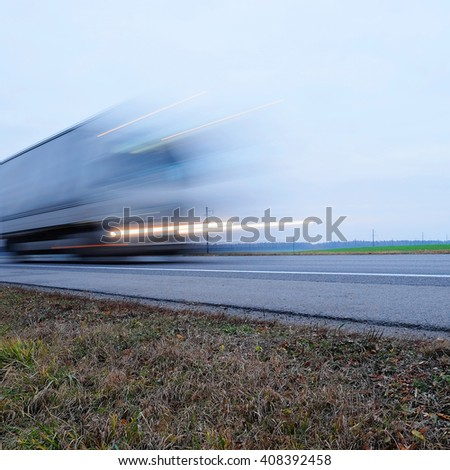 Truck on a hughway  blurred because of movement - stock photo