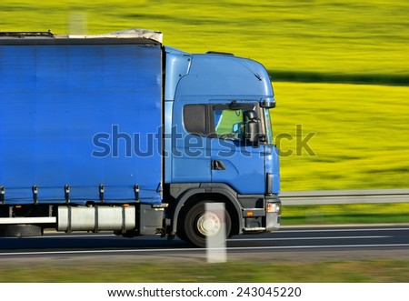 truck on a road - stock photo