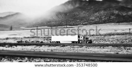 Truck on Arizona interstate - stock photo