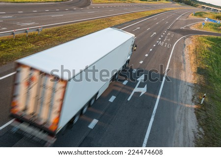Truck on road, motion blur - stock photo