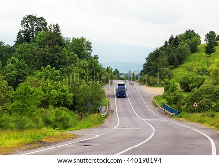 Truck on rural road in motion