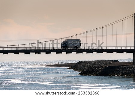 truck on the bridge of jokulsarlon Lake in Iceland - stock photo