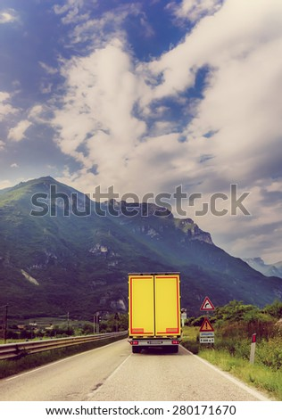 truck on the road.  Yellow cargo car
