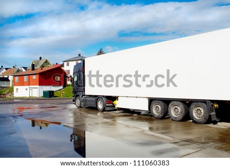 Truck on the streets of a small town after rain