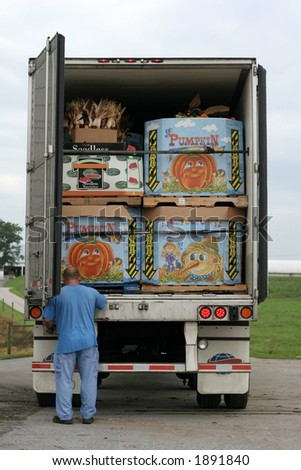 truck packed with boxes filled with pumpkins - stock photo