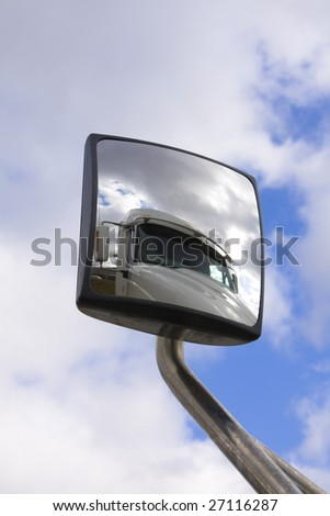 Truck reflected in it's own mirror - stock photo
