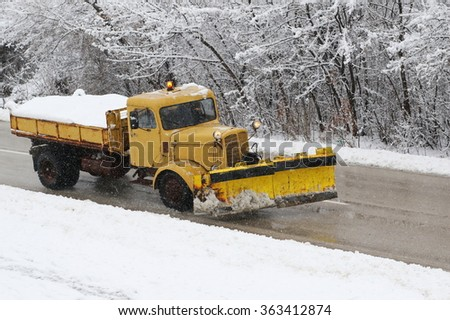 Truck snowblowers, machinery with snowplough cleaning road