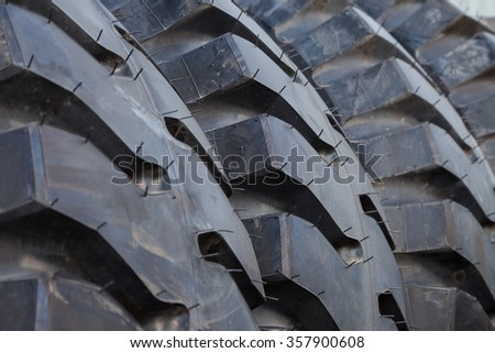 Truck tire stack background Selective focus. Background. Backgrounds. Texture - stock photo