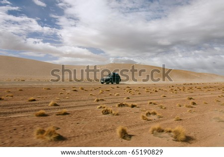 Truck tour scenery from the Bolivian desert. - stock photo