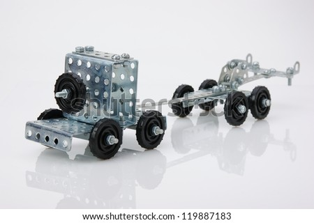 truck tractor toy - metal kit for construction on white background