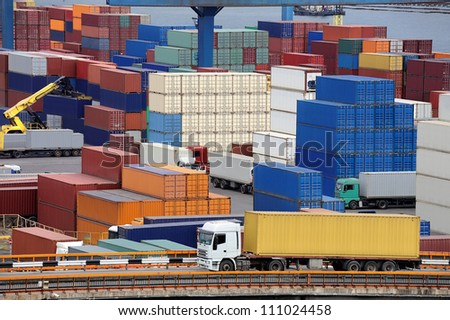 truck transport container to a warehouse near the sea - stock photo