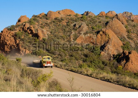 Truck traveling on a mountain road - stock photo