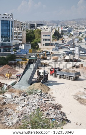 Truck unload earth on a construction site in Limassol,Cyprus - stock photo