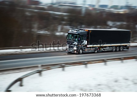 truck with freight moving fast  - stock photo