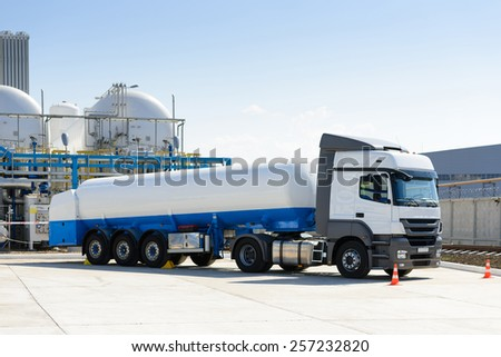 Truck with fuel at the plant - stock photo
