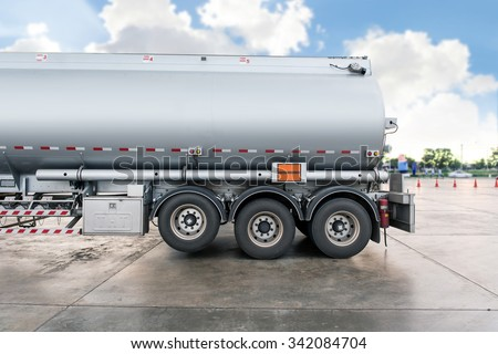 Truck with fuel tank in gas station - stock photo