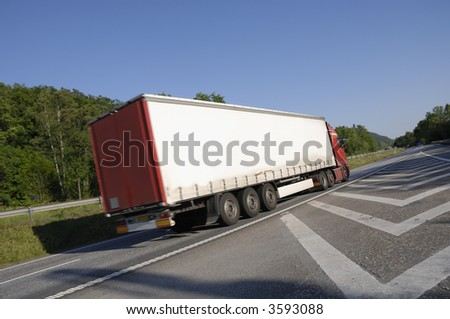 truck zooming past, tilted perspective - stock photo